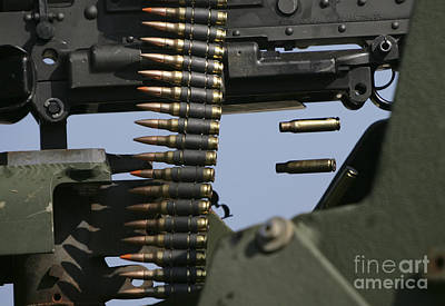 Expended Brass Falls From A Machine Gun Poster by Stocktrek Images