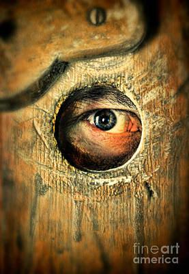 Eye Looking Through Peep Hole Poster