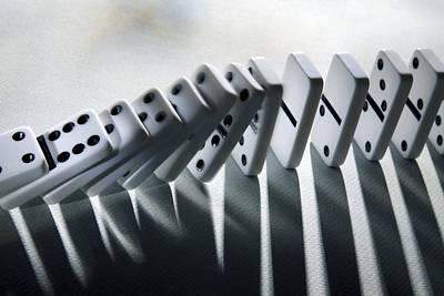 Falling Dominoes Poster by Victor De Schwanberg