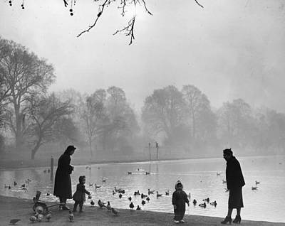 Feeding Ducks Poster by Fox Photos