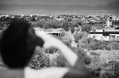 female tourist using binoculars to overlook the UN buffer zone cyprus Poster