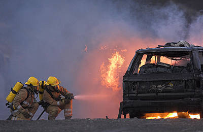 Firefighters Hosing A Burning Car Poster