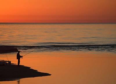 Fisherman At Sunset Poster
