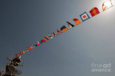 Flags Fly Over The Deck Of The Uss Iwo Poster by Stocktrek Images
