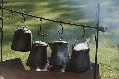 Four Metal Coffee Pots Steaming Over An Poster