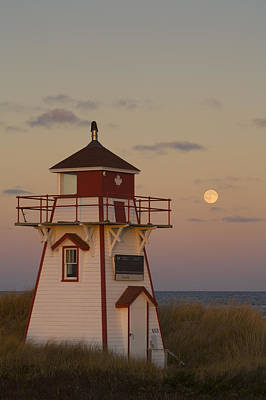 Full Moon Over Covehead Lighthouse Poster by John Sylvester