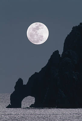 Full Moon Rising Over A Coastal Cliff Poster