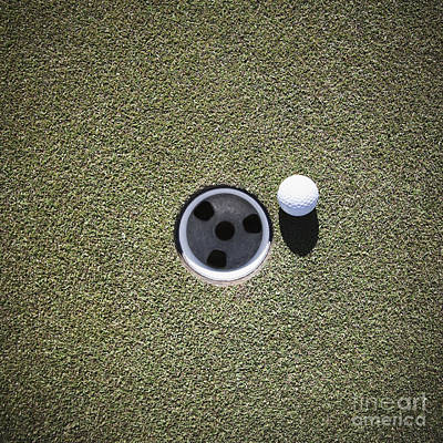 Golf Ball Next To A Putting Cup Poster