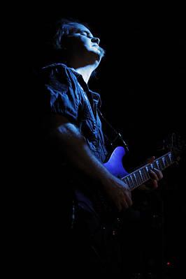 Guitarist In Blue Poster by Rick Berk