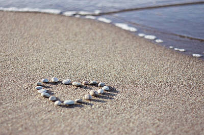 Heart Made Of Pebbles On Sand Poster