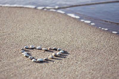 Heart Made Of Pebbles On Sand Poster by Angelika Kaczanowska