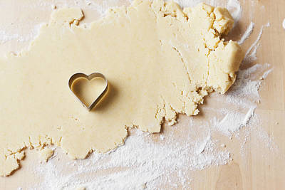 Heart Shaped Cookie Cutter On Dough Poster