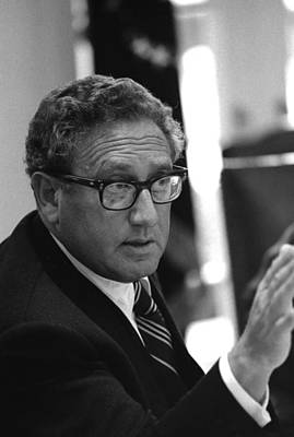 Henry Kissinger In A Meeting Following Poster