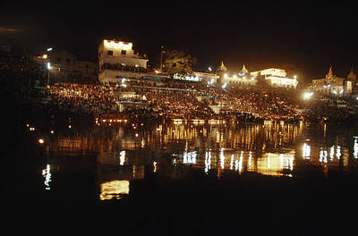 Hindus Line The Ghat At Night To Float Poster by James P. Blair