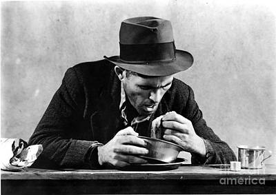 Homeless Man Eating In A Soup Kitchen Poster by Photo Researchers