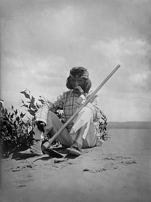 Hopi Man Sitting On Ground Smoking Poster