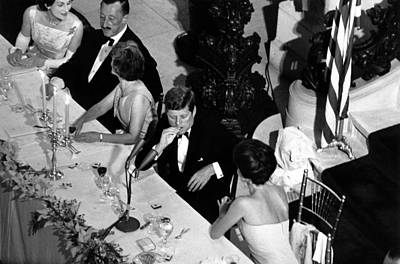 Jacqueline Kennedy Leans Over To Talk Poster by Everett