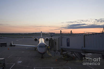 Jet Bridge Being Attached To Canadair Crj-200 Poster by Christopher Purcell