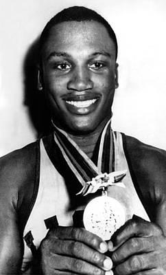 Joe Frazier Holding Olympic Heavyweight Poster