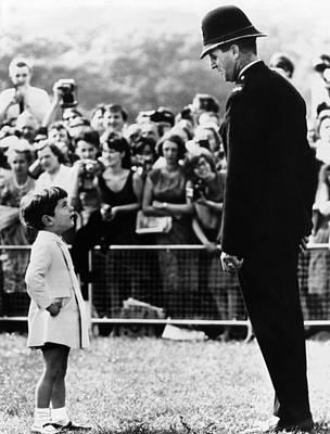 John F. Kennedy Jr. Looks Poster by Everett
