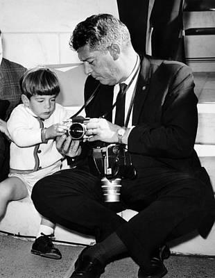 John F. Kennedy Jr. Takes An Interest Poster by Everett