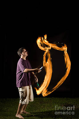 Juggling Fire Poster by Ted Kinsman