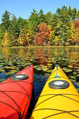 Poster featuring the photograph Kayaks In The Fall by Rick Frost