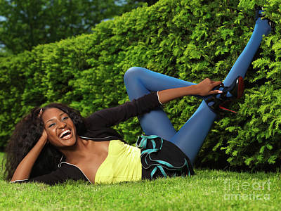 Laughing Young Woman Lying On The Grass Poster