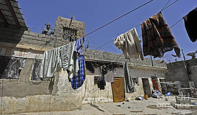 Laundry Hangs In The Courtyard Poster