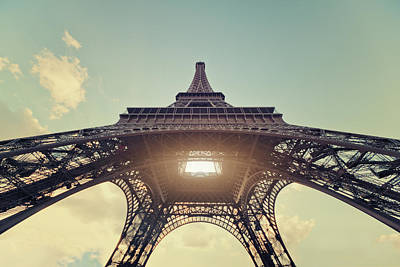 Light Shining Through Eiffel Tower Poster by Philipp Klinger