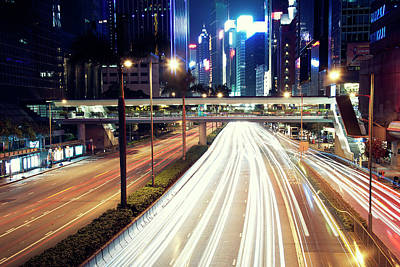 Light Trails At Traffic On Street At Night Poster