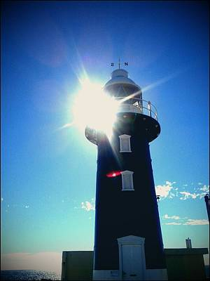 Poster featuring the photograph Lighthouse In The Sunlight by Roberto Gagliardi