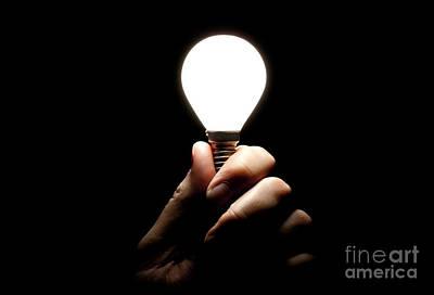 Lit Lightbulb Held In Hand Poster by Simon Bratt Photography LRPS