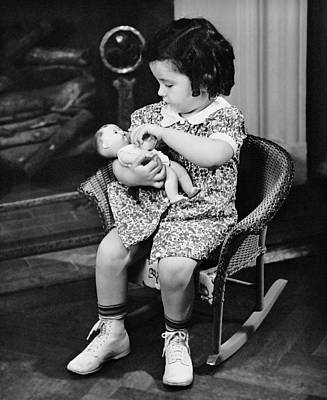 Little Girl Playing With Doll Poster by George Marks