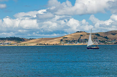 Luxury Yacht Sails In Blue Waters Along A Summer Coast Line Poster