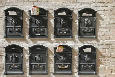 Mailboxes Lined On A Stone Wall Poster by Gina Martin