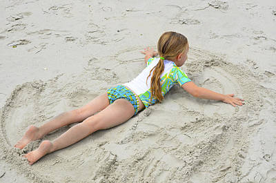 Poster featuring the photograph Making A Sand Angel by Maureen E Ritter
