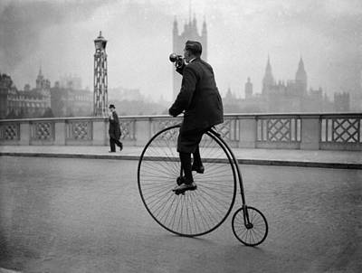 Man Rides A Penny Farthing Bicycle Over Lambeth Bridge, London Poster by Fox Photos