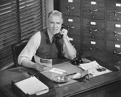 Man Sitting At Desk, Talking On Phone, (b&w), Elevated View Poster