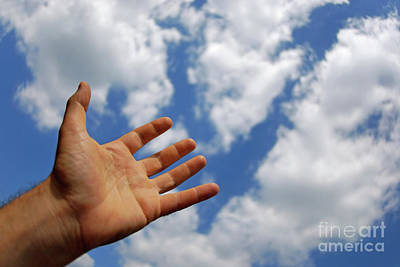 Mans Hand Reaching For Clouds Poster