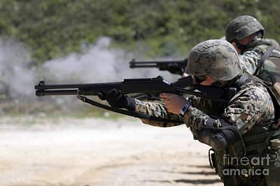Marines Firing Shotguns Poster by Stocktrek Images