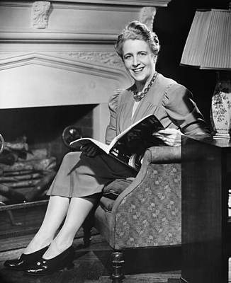 Mature Woman Sitting In Armchair, Holding Magazine, (b&w), Portrait Poster by George Marks