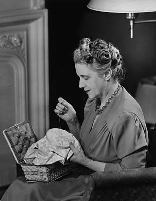 Mature Woman Sitting In Living Room, Doing Needlepoint, (b&w) Poster