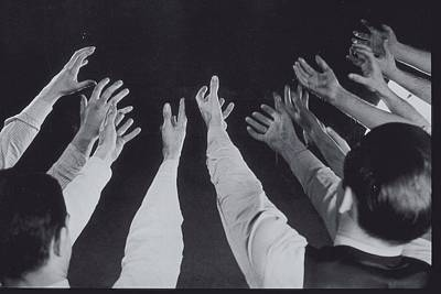 Mens Hands Reaching Out Into Blackness Poster