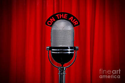Microphone On Stage With Spotlight On Red Curtain Poster
