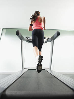 Mixed Race Woman Running On Treadmill Poster