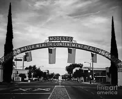 Modesto Arch With Flags Poster by Jim and Emily Bush
