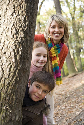 Mother And Children Playing In A Wood Poster