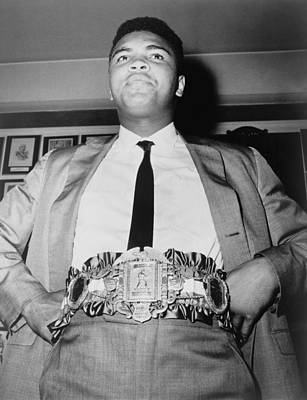 Muhammad Ali B. 1942, Displays The Poster by Everett