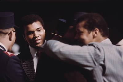 Muhammad Ali Talks With Fellow Black Poster